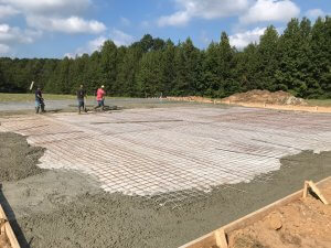 Oconee workers laying down a concrete foundation in Macon, GA